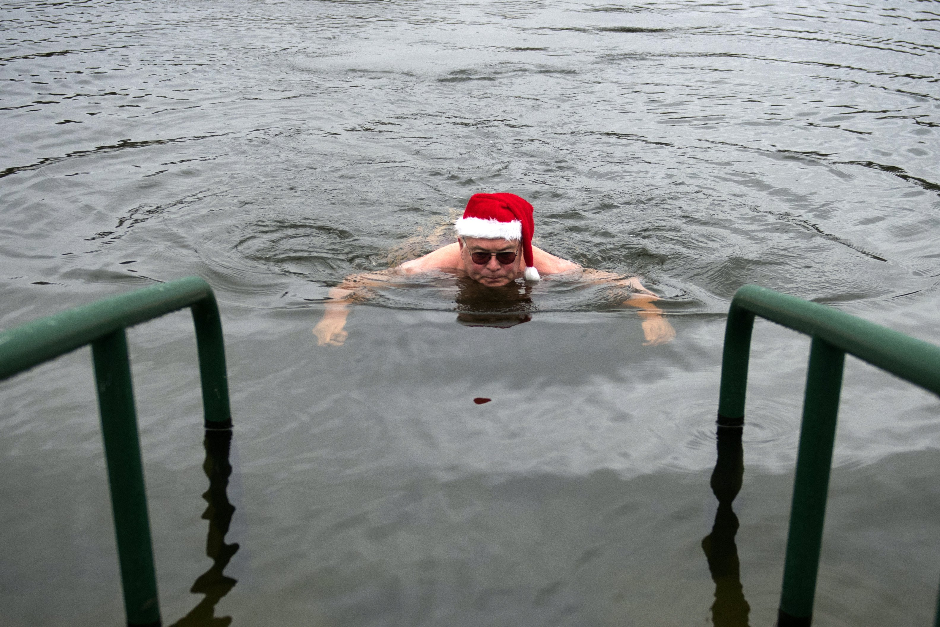 Swimmers take part in the annual Christmas Day swim in Hyde park